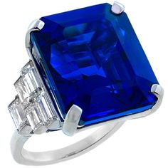 Tanzanite Diamond Platinum Ring. This platinum ring centers a high quality tanzanite weighing 29.56 carat, which is accentuated by sparkling baguette cut diamonds weighing approximately 3 carat. The color of the diamonds is F with VS1 clarity. c 2000