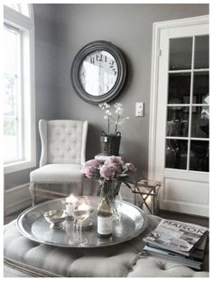 Love the big tray on a tufted ottoman for a sitting room.