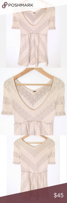 Free People Cream Blush V Neck Mini Dress This dress is flirty, flattering and in excellent pre loved condition.  The color is a nice shade of cream blush and this looks great with boots and a cropped jacket. Free People Dresses Mini