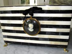 Black & White striped counter; I think I can make this on the back of my dresser from when I was a kid, and use it as a kitchen island. Would it look cute with pink cabinets and black/white tile floor? Why yes, yes it would.