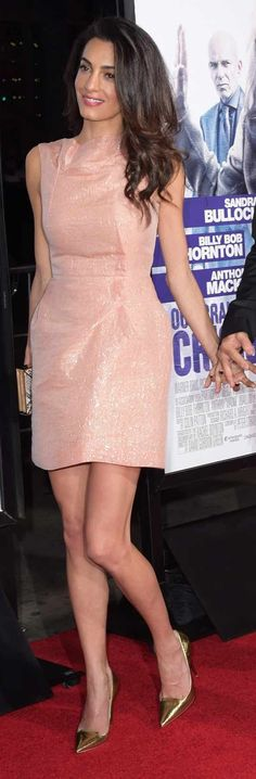 "Amal Clooney in Roland Mouret paired with a Salvatore Ferrgamo clutch attends the L.A. premiere ""Our Brand Is Crisis""."