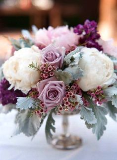 8 Exceptional Purple Color Combos purple wedding centerpieces<br> Send Cool waters in Granbury, TX from Town and Country Floral Gallery, the best florist in Granbury. All flowers are hand delivered and same day delivery may be available. Wedding Table Centerpieces, Wedding Flower Arrangements, Wedding Bouquets, Wedding Decorations, Wedding Ideas, Centerpiece Ideas, Centerpiece Flowers, Flower Bouquets, Wedding Hacks