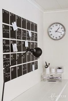Super sleek use of magnetic chalkboard paint for an office wall calendar. You can magnetize the clothes pins, or use rare earth magnets to keep notes and other papers on the wall.