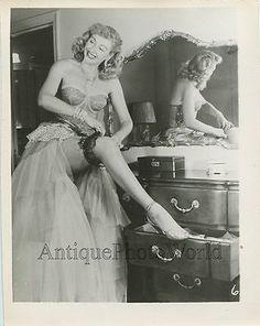Sexy woman burlesque dancer showing leg with garter belt vintage pin up photo