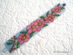 De geboorte van de bloemen te vissen in het voorjaar. Na een lange slaap, is alles zachtjes aard ontwaakt... Dergelijke deze bloemen te vissen op deze mooie lente manchet samengesteld van veelkleurige kralen zijn met de hand geweven in de naald met een zeer lange draad van witte