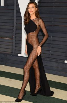 Hard to mesh: Irina Shayk arrived at the Vanity Fair Oscars bash in a very revealing gown ...