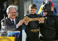 "FIVE-YEAR-OLD leukemia survivor Miles Scott, dressed as ""Batkid"" receive a key to the city declaring him ""Junior Mayor"" from San Francisco M..."