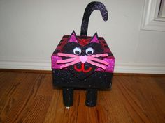 cat valentines box made from a shoe box and toilet paper roll legs