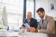 Caucasian businessmen using digital tablet in office