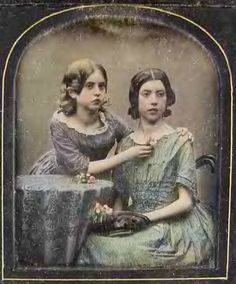 Oh, how I wish there was some information attached to this daguerreotype. It is totally arresting. The tinting is amazing. The infant necklines edged with lace, the rucking, the absence of belts indicate1840s. The girls' attention on something other than the camera gives it a wonderful reality. I have a feeling it is French.