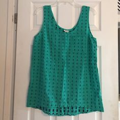 Turquoise with navy blue detail sleeveless top Hardly worn. Pocket on the left. Slightly Higher in the front. No trades. Price negotiable! Merona Tops