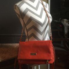 BCBG Purse NWT BCBG purse- color is burnt orange, but the color tag says RED. Shoulder strap. BCBG Bags Shoulder Bags