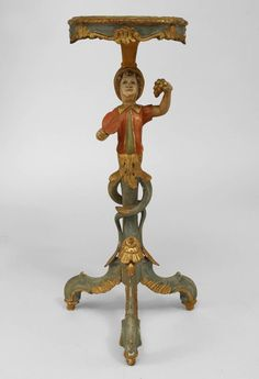 Italian Venetian style (19/20th Cent) polychromed pedestal stand with a figure of a young boy hold and paddle and grapes