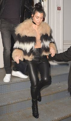 Make a sleek bodysuit and leather pant combo more interesting by pairing it under a bold topper.