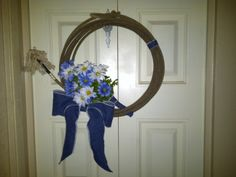 Instant wedding decoration. I used one used lasso, from feed store. A piece of denim, old jeans, and dried flowers from the dollar store. I looked great too!