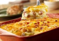 Ordinary scalloped potatoes become extraordinary when they're made with ham, onion and a creamy cheese sauce. They make anappetizing addition to just about any meal.