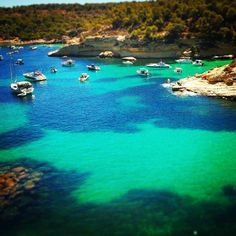 Summer in Mallorca in one image would look like this. Playa mago in calvia is a lovely little set of coves with sand and crystal clear water. There's even a chirringuito!!