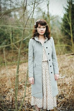 Love the coat and hair, don't love the midi-length, but would be cute a little shorter with grey tights.