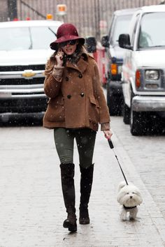Actress Olivia Palermo wearing a large hat seen out and about with her puppy in New York.