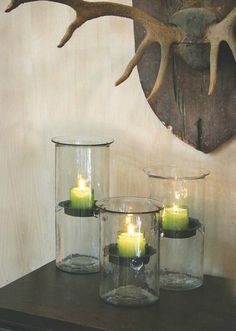 You'll love your favorite pillar candles even more when you place them in these handblown glass candle holders. With the rustic inserts, you can give any candle a gravity-defying quality.