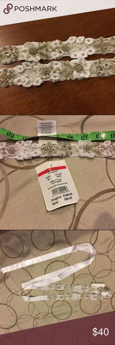 "Davids Bridal Bridal Sash Davids Bridal Bridal sash. Bright white. Detailed part of sash is approx 30"" plus ribbon on each side. New never used.  Went with a colored sash instead. David's Bridal Accessories Belts"