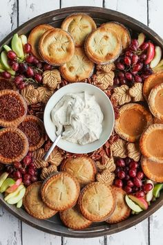 Host a fall gathering with a Fall Mini Pie Dessert Board. Use fall flavored mini pies–pumpkin, pecan, apple, and sweet potato. Serve with spiced cream! Charcuterie Recipes, Charcuterie And Cheese Board, Cheese Boards, Thanksgiving Recipes, Fall Recipes, Holiday Recipes, Thanksgiving Prayer, Thanksgiving Appetizers, Thanksgiving Outfit