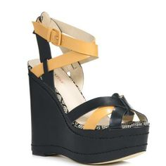 You need this wedge now. Striking neon straps on an extreme-platform silhouette will score you serious style points.