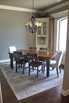 """James+James 6.25'x37"""" Baluster Turned Leg Table with a traditional top stained in Dark Walnut. Pictured with Henry dining chairs."""