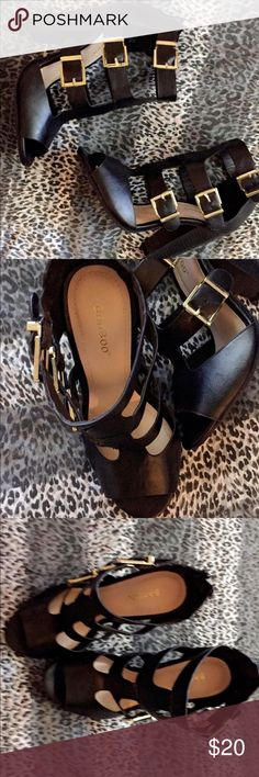 Black high heels with gold belt loopings High heel black heels with gold belt looping , never worn size 6.5 Deb Shoes Heels
