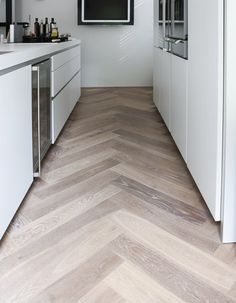 Wood look tile set in a harringbone pattern