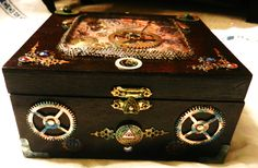 Front View: Steampunk Gothic Treasure Jewelery Box, with Trilobites & Time Keeper Images, brass & copper patina paint / varnish, as well as natural rust & weathering, faux gems, Vintage clock crystal,  watch & clock parts & gears, altered cigar box.