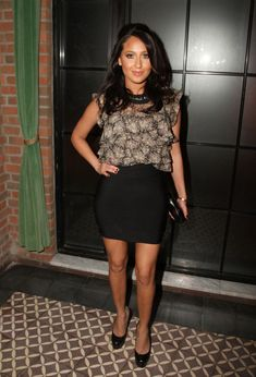 Adrienne Bailon Half Up Half Down - The mini skirt clad popstar posed with a…