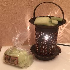 Warm Glow Scent Chips ~ wonderfully fragrant flameless product that will liven up your room without the concern of burning a candle. These pieces are random sized, intended for use in tart burners.  They come in 1/4 lb. cellophane wrapped bags. Willow warmer pictured not included.