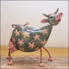 Pink and grey starry ceramic cow with copper wire parts. More of my cow sculptures can be seen in my website gallery My ceramic animals are on facebook too and Google+
