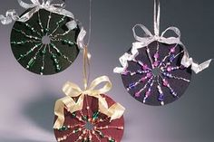 The beaded CD ornaments shown above admirably recycle the old CDs you might have around