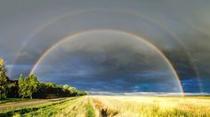 The Span of a Rainbow.  Shown above are two magnificent rainbows. The top one (a double bow) taken from Boulder, Colorado, near sunset on the evening of August 27 and the bottom one taken from Barrabool, Victoria, Australia, in the afternoon of July 10, 2014. Both primary rainbows span the same amount of sky, but the Boulder bow arches higher that the Barrabool bow since it was taken closer to sunset.