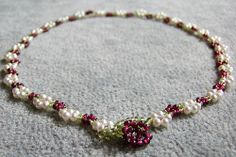 Roses. Exploring Diamond Weave with extensions and thread cover beads. Freshwater pearls, garnet, peridot beads.
