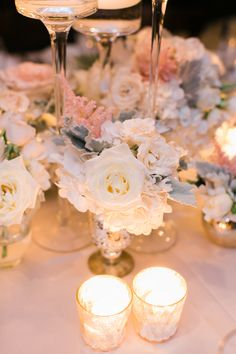Centerpiece of Roses and Dusty Miller | photography by http://www.artistrieco.com