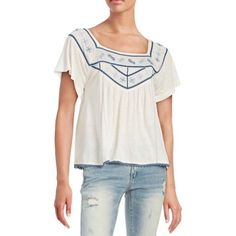 Free People blue embroidered t-shirt Cute loose fitting t-shirt from Free People. New without tags. Label has marking -- see last pic. Soft t-shirt material with blue embroidered details. Size XS. If you need measurements, please ask! Open to reasonable offers. Free People Tops Tees - Short Sleeve