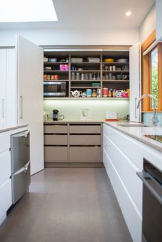 Kitchen 654. Sally Steer Design Ltd. Wellington, NZ. Custom routed handles and no handles in pantry.
