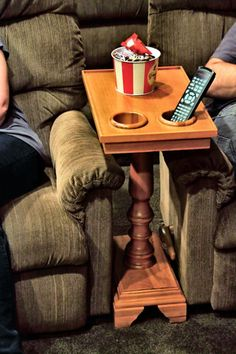 For dad. The ChairSide fits comfortably alongside your favorite chair or couch and will help you enjoy an Oscar winning movie or follow your favorite team as they play a big game. Your snacks are always secure from sliding off the table top with a gallery trimmed lip along the edge. The cup holders are built-in and can hold everything from wine bottles to red plastic cups.