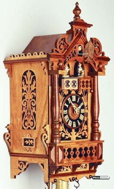 Stunning antique replica cuckoo clock 8-day-movement  by Rombach & Haas. A handmade gem from the Black Forest.
