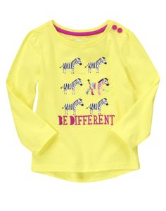 Be Different! A crazy cute zebra shows off her bright stripes on a soft tee.