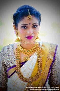 Our gorgeous bride Pavithra sets new goals for brides! She looks ravishing for her muhurtam. Makeup and hairstyle by Vejetha for Swank Studio. Photo credit: Manish Ananda. Berry lips. Smokey eye makeup. Maang tikka. Jhumkis. Bridal jewelry. Bridal hair. Silk sari. Bridal Saree Blouse Design. Indian Bridal Makeup. Indian Bride. Gold Jewellery. Statement Blouse. Tamil bride. Telugu bride. Kannada bride. Hindu bride. Malayalee bride. Find us at https://www.facebook.com/SwankStudioBangalore