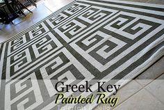 http://tatertotsandjello.com/2012/07/scotch-blue-painters-tape-taped-greek-key-rug.html