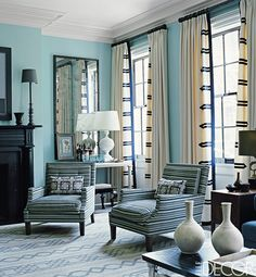 In the living room of his townhouse in Manhattan's West Village, designer Steven Gambrel hung curtains with bold contrasting trim modeled after that on a naval uniform. Gambrel also designed the rug and the club chairs, which are upholstered in a chenille from Carleton V; the custom-mixed wall color is by Fine Paints of Europe.   - ELLEDecor.com