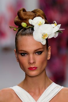 5. Issa LFW Spring 2013: the hairstyle in this look was inspired by the A La Chinoise hairstyle worn by women during the romantic period, with its back and side hair pulled up into a knot at the top of the head.