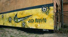 ღღ Nike Joga Bonito Commercial (Image credit: DNAike Tony) ~~~ Nike graffiti with soccer balls drawn embedded within the wall.