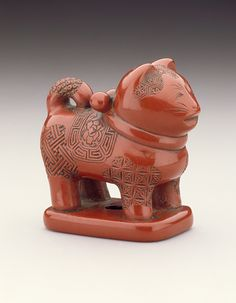 Japan  Toy Dog, 19th century  Netsuke, Carved red lacquer. LACMA