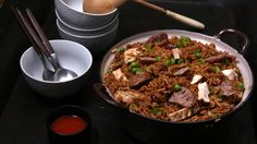 For foodies craving some New Orleans flavor but short on time, try this recipe for Chicken Jambalaya. First, cook the bacon and save the drippings. Mix the chicken and green pepper with drippings in same skillet and brown chicken, about 3 minutes. Stir in water, Knorr® Cajun Sides™ - Red Beans & Rice and peas. Boil, then reduce the heat to low and simmer, stirring occasionally, 5 minutes or until chicken is thoroughly cooked and rice is tender. Stir in hot pepper sauce.